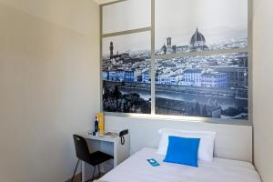 A bed or beds in a room at B&B Hotel Firenze Novoli