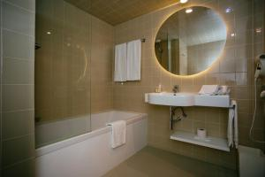 A bathroom at Axis Vermar Conference & Beach Hotel