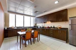 A kitchen or kitchenette at Abidos Hotel Apartment Dubai Land