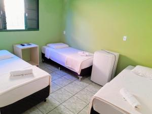 A bed or beds in a room at Hotel Guaíba