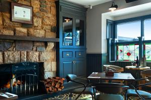 A restaurant or other place to eat at Harrigan's Irish Pub & Accommodation