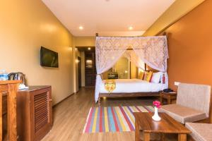A bed or beds in a room at Hotel Mala Pokhara