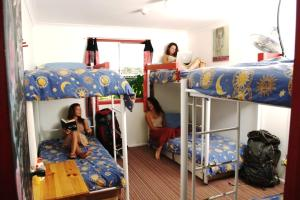 A bunk bed or bunk beds in a room at Beachside Backpackers