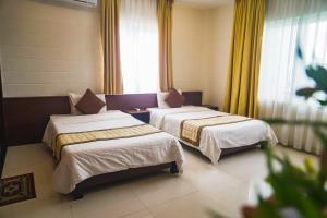 Giường trong phòng chung tại Dai A Hotel