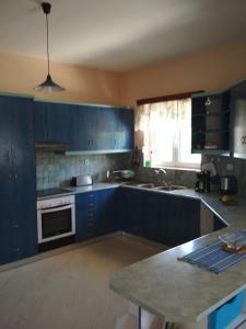 A kitchen or kitchenette at Villa Doxa