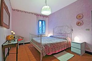 Letto o letti in una camera di Antica Locanda La Canonica