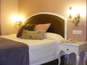 Cama o camas de una habitación en Hotel Sindhura