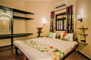 A bed or beds in a room at Boons Ark Anjuna Goa