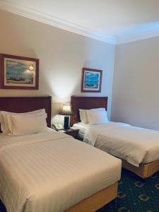 Cama ou camas em um quarto em Boudl City Center Hotel