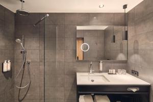 A bathroom at Van der Valk Hotel Antwerpen