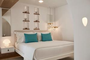 A bed or beds in a room at Nikki Beach Resort & Spa Santorini