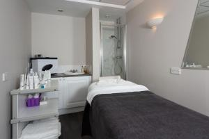 A bed or beds in a room at Ardoe House Hotel & Spa