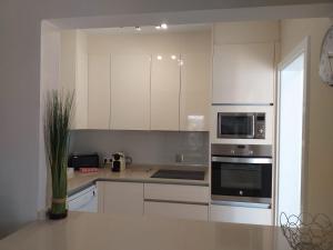 Cuisine ou kitchenette dans l'établissement Villa Jaira