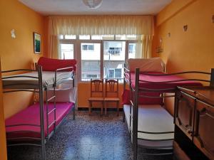 A bunk bed or bunk beds in a room at Albergue Por Fin