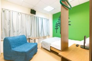A bed or beds in a room at Taiga Nsk