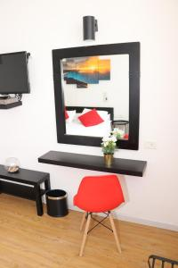 A television and/or entertainment center at Inbar Hotel
