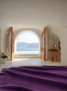 Un ou plusieurs lits dans un hébergement de l'établissement Perivolas Hotel