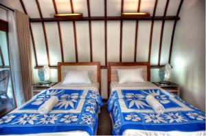 A bed or beds in a room at The Yoga Garden