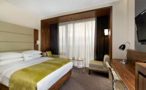 A bed or beds in a room at DoubleTree by Hilton Zagreb