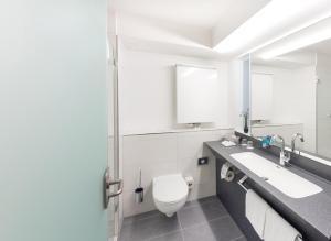 Ein Badezimmer in der Unterkunft Hotel Alarun