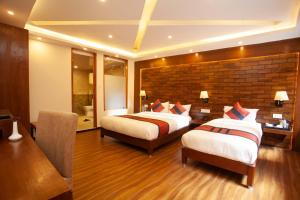 A bed or beds in a room at Hotel Jampa