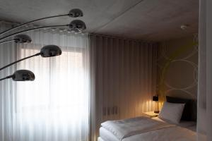 A bed or beds in a room at Hotel Banks