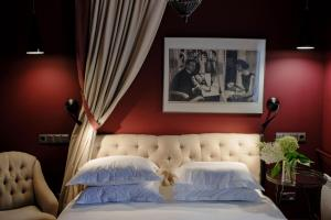 A bed or beds in a room at Vozdvyzhensky Boutique Hotel