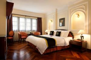 A bed or beds in a room at Hotel Majestic Saigon