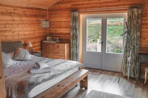 A bed or beds in a room at The Courtyard at Wainhill