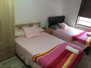 Cama o camas de una habitación en Piso en el húmedo, al lado plaza mayor