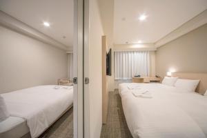 京都八條口相鐵弗雷薩經濟型酒店房間的床