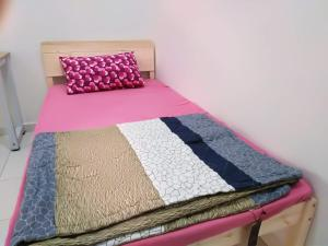 A bed or beds in a room at Jerantut Homestay 2