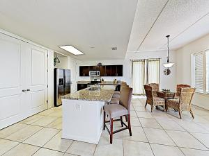A restaurant or other place to eat at New Listing! Modern Beach Condo With Infinity Pool Condo
