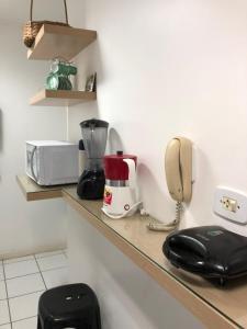 A cozinha ou cozinha compacta de Apartamentos Praia de Pajucara