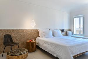 Un ou plusieurs lits dans un hébergement de l'établissement Arota Exclusive Villas