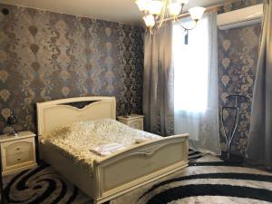 Кровать или кровати в номере Гостиница Тула