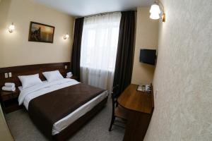 Кровать или кровати в номере Алые Паруса