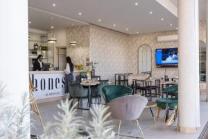 A restaurant or other place to eat at One Hyde Park - Sandton