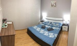 A bed or beds in a room at Flori hotel