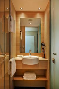 Kúpeľňa v ubytovaní H2 Hotel München Messe