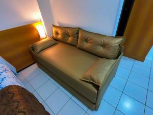 A seating area at Ponta Negra Flat 504