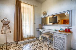 A kitchen or kitchenette at S3 Hotels Orange