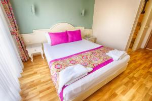 A bed or beds in a room at S3 Hotels Orange