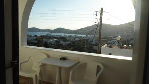 A balcony or terrace at Homer's Inn Hotel