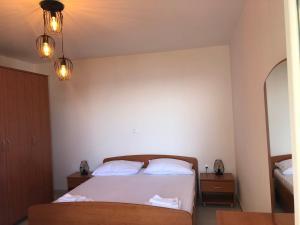 Postel nebo postele na pokoji v ubytování Adriatic House