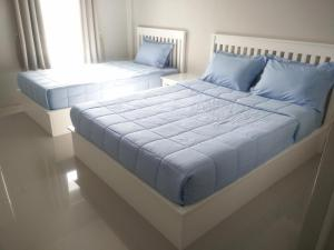 A bed or beds in a room at Vanilla Ville Resort