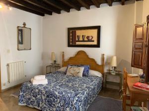 Cama o camas de una habitación en Charming Apartments De Gomerez