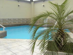 The swimming pool at or close to De Rose Palace Hotel