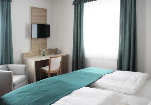 Ein Bett oder Betten in einem Zimmer der Unterkunft Hotel Esmer
