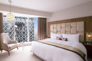 A bed or beds in a room at City of Dreams- The Countdown Hotel